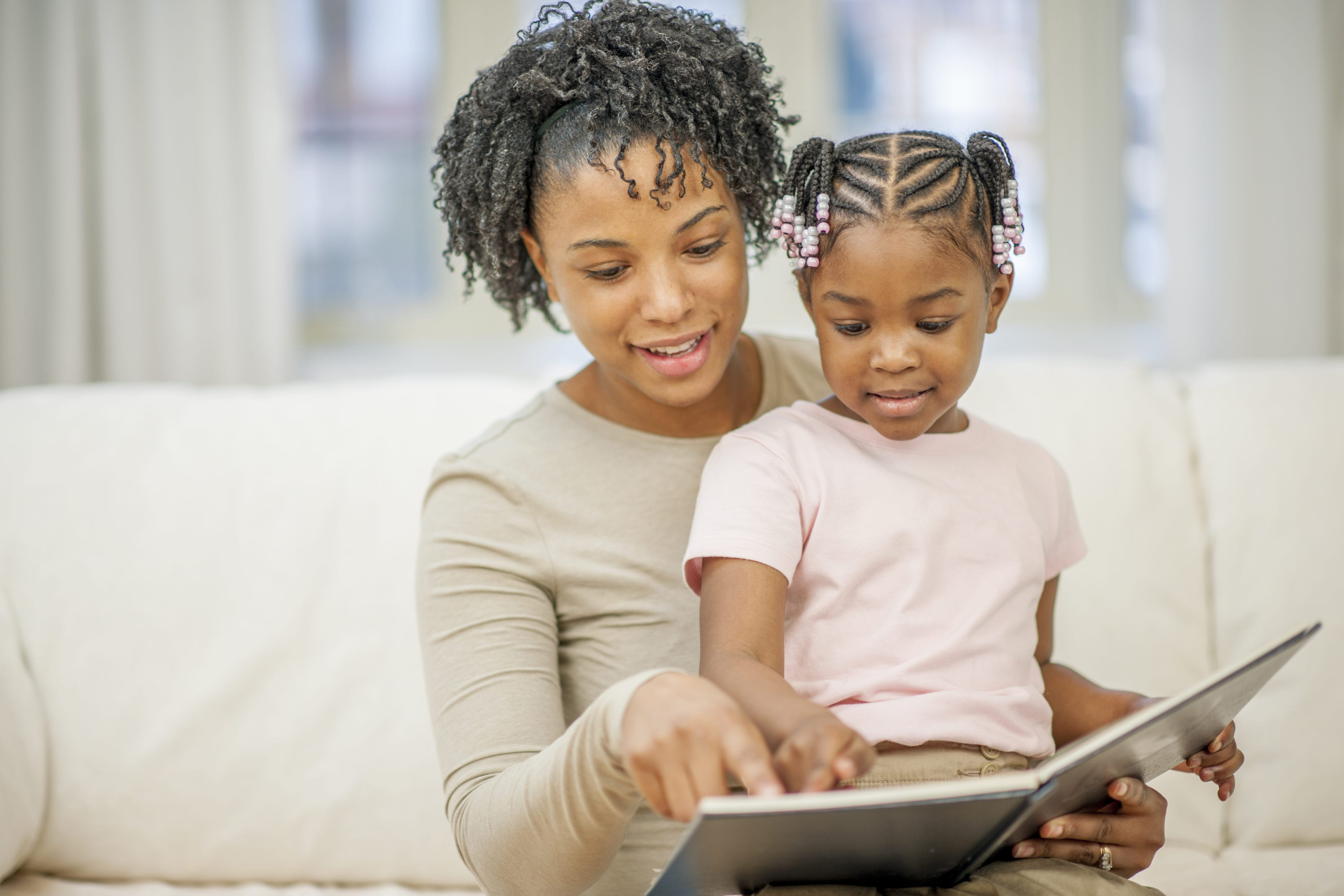 Mother Reading a Book to Her Little Girl - Bellingham ...