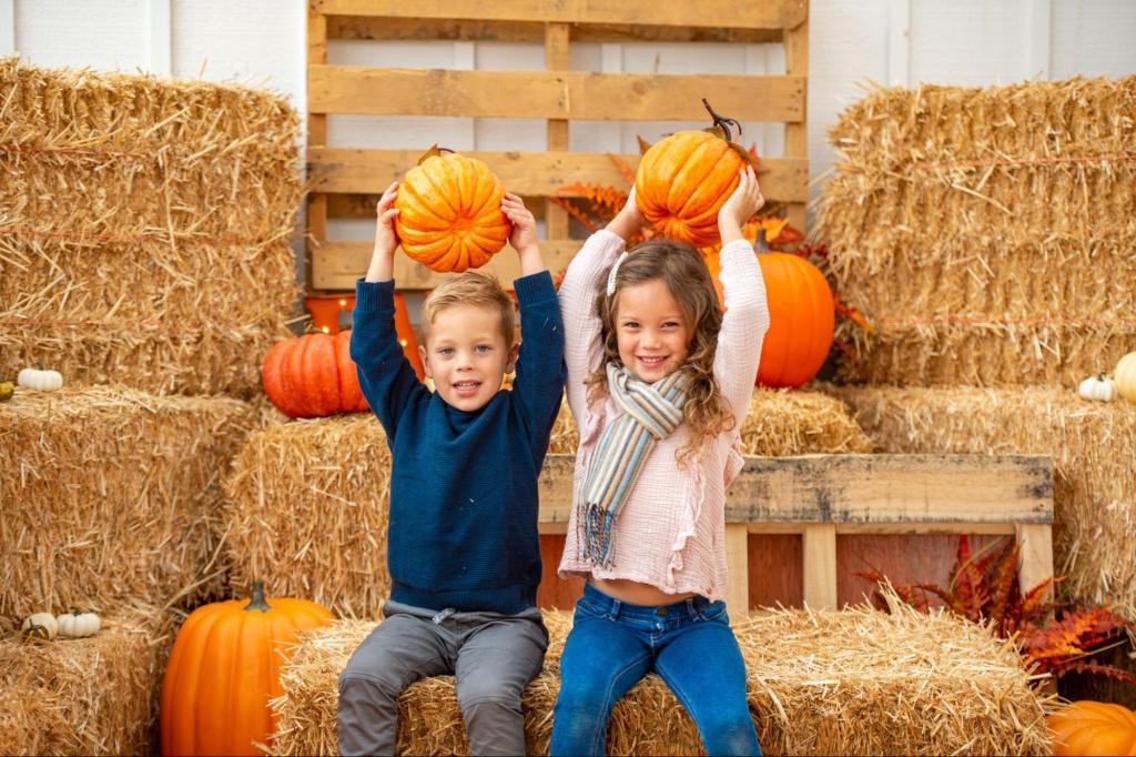 two kids holding pumpkins over their head