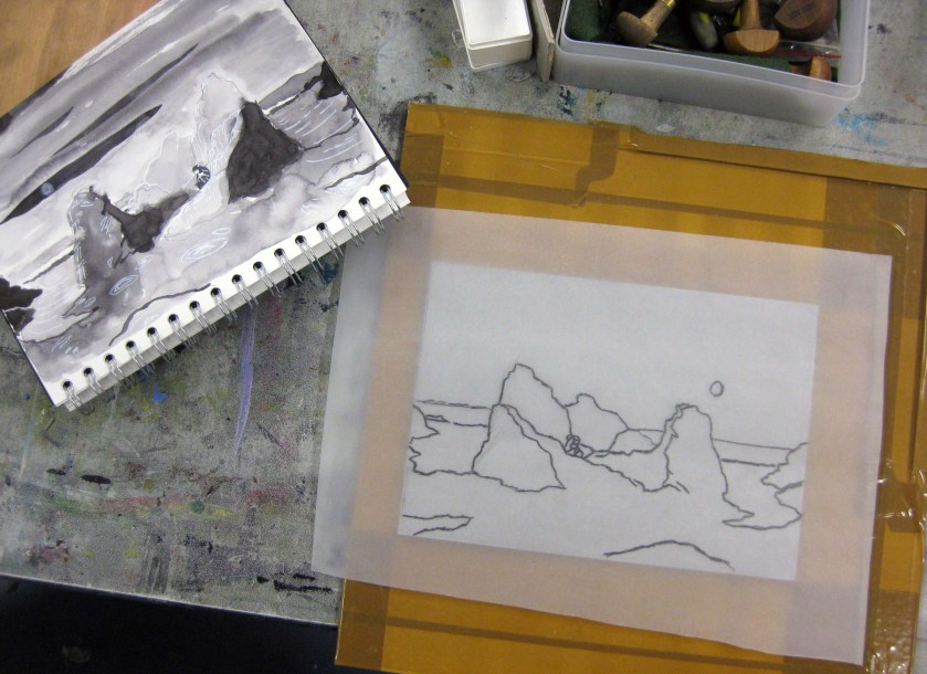 Tracing a sketch onto the lino.