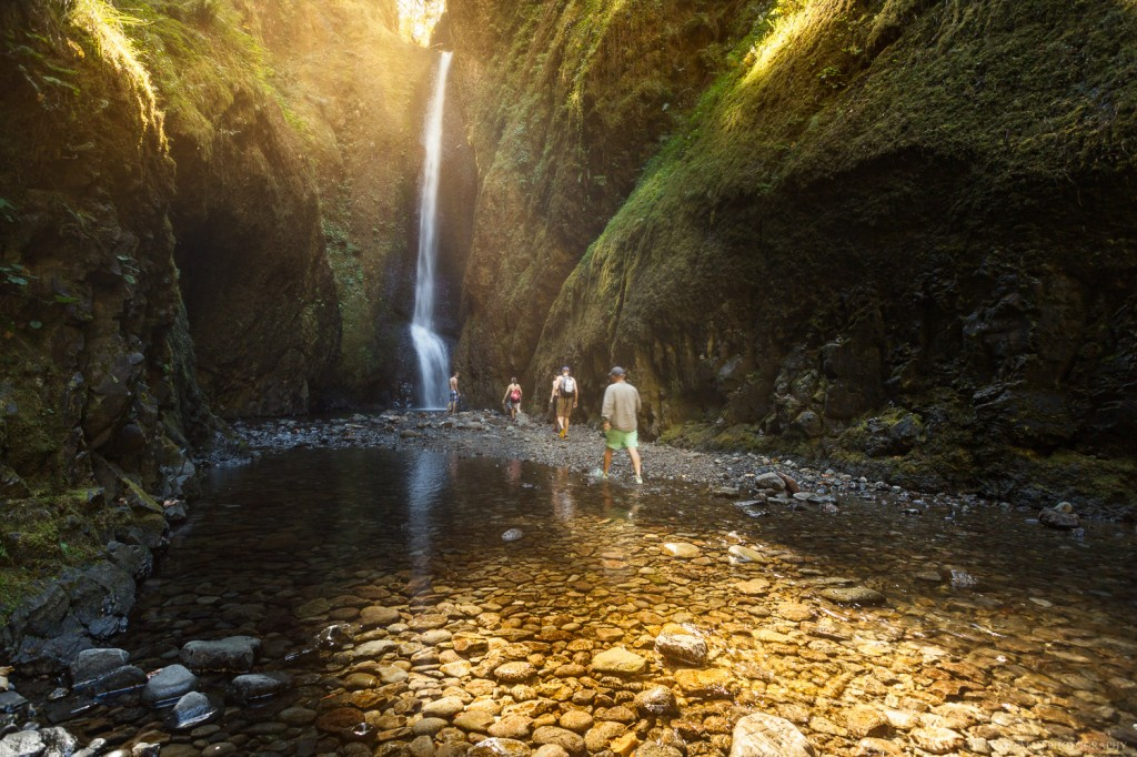 Hikers make their way through the creek in Onenta Gorge.