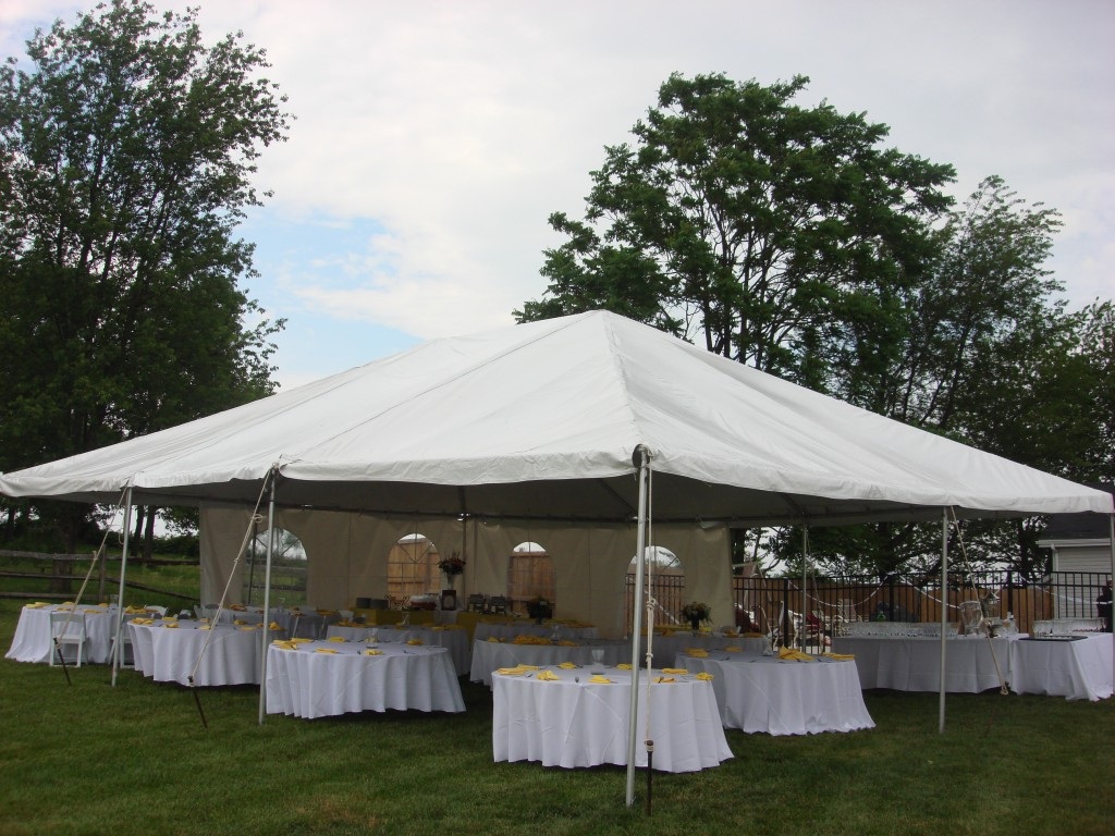 Leg drapes dress up this 30X70 frame tent rental in July. The leg drapes are gathered and tied in the center giving a finished feel. & Tent Leg Drapes - A Must Have for Formal Tent Rentals