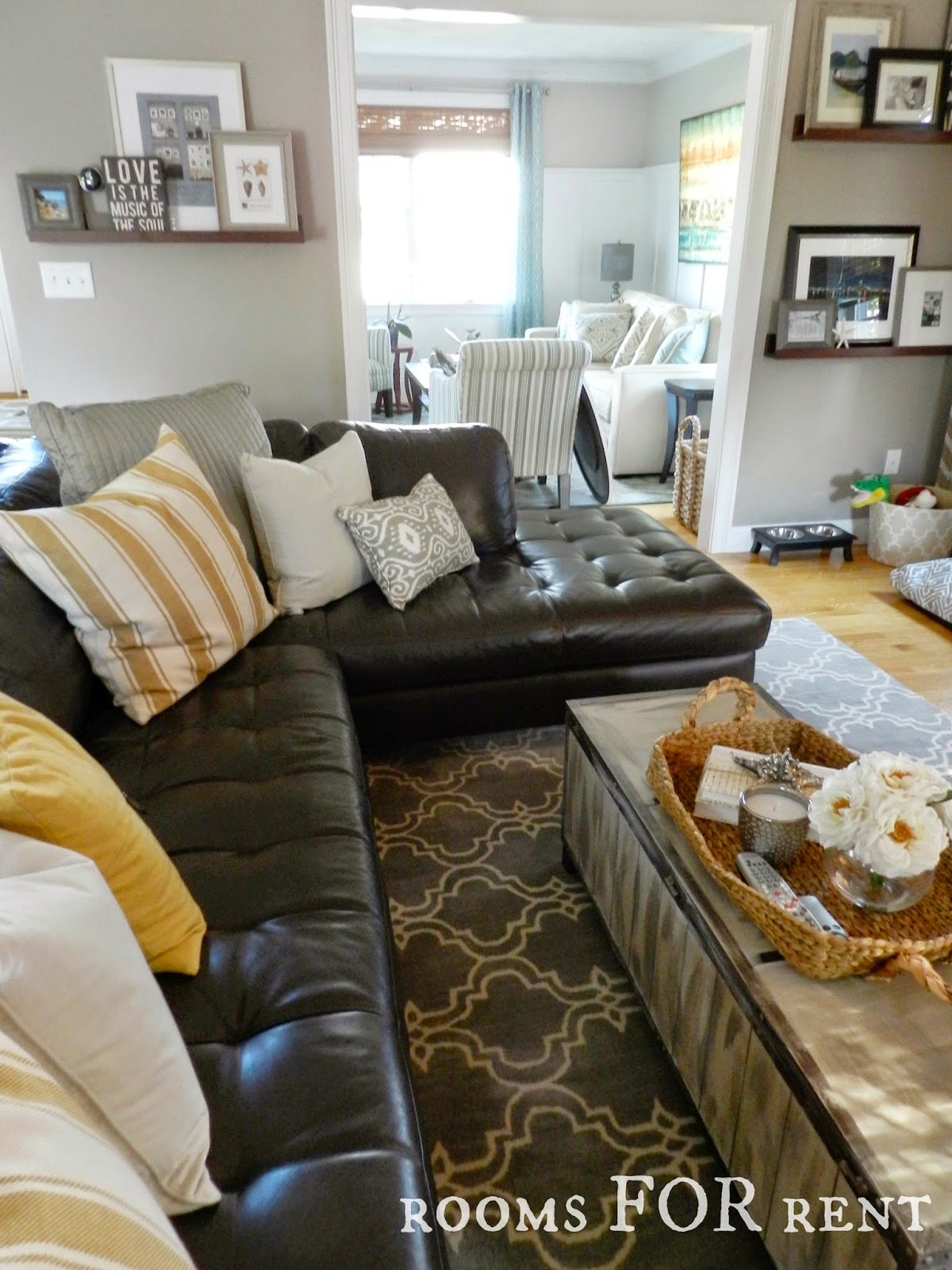 brown leather couch living room feature wall ideas for how to style a dark sofa den makeover beneath my heart