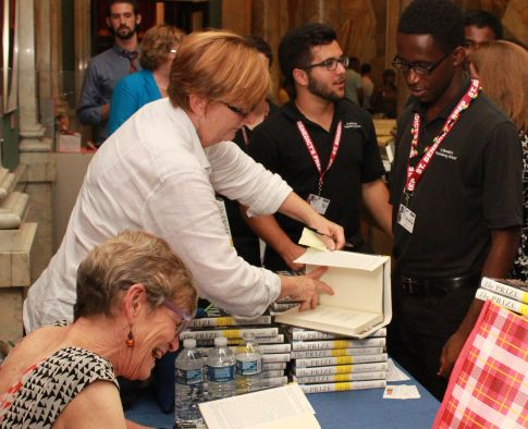 Editor-in-Chief Andrew Sosanya and Sports Editor Rui De Olivera have their books signed.