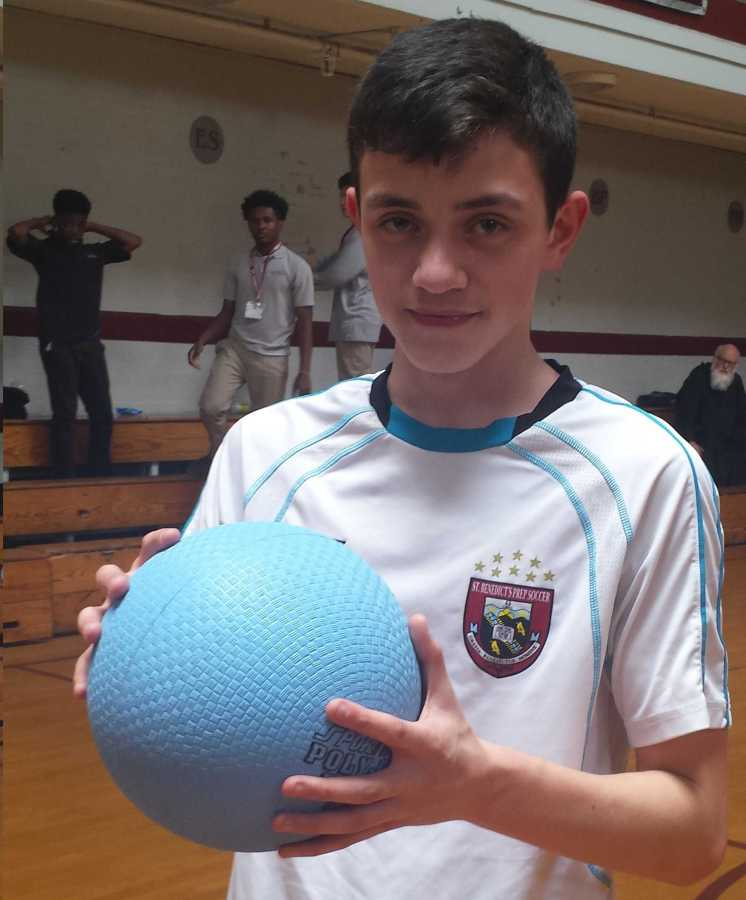 UDI Fabian Rojas holding the ball he used to shoot a game changing three-pointer.