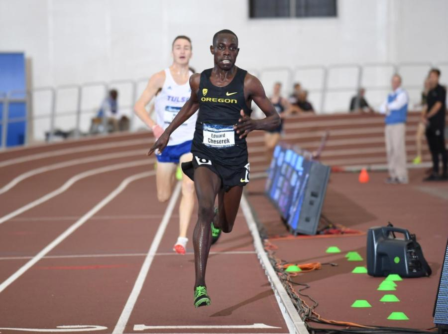 Edward Cheserek'13 crossing the line in the 5000-meter run to earn his 16th NCAA title