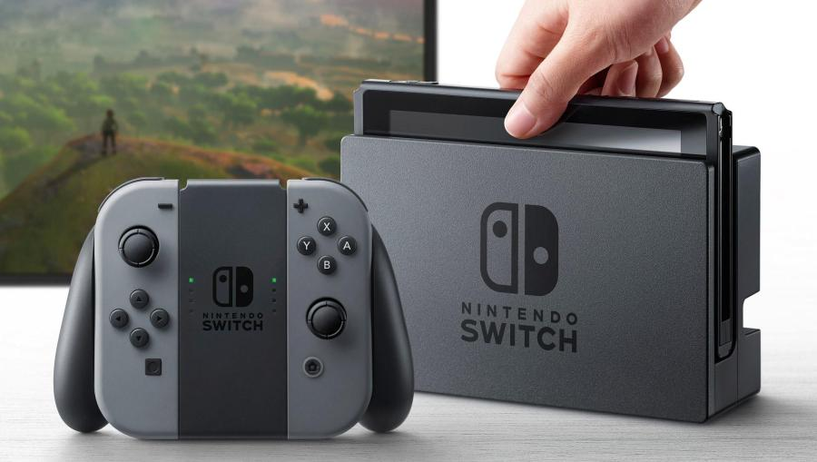 Photo of the System, the controllers and the Joy Con grip.