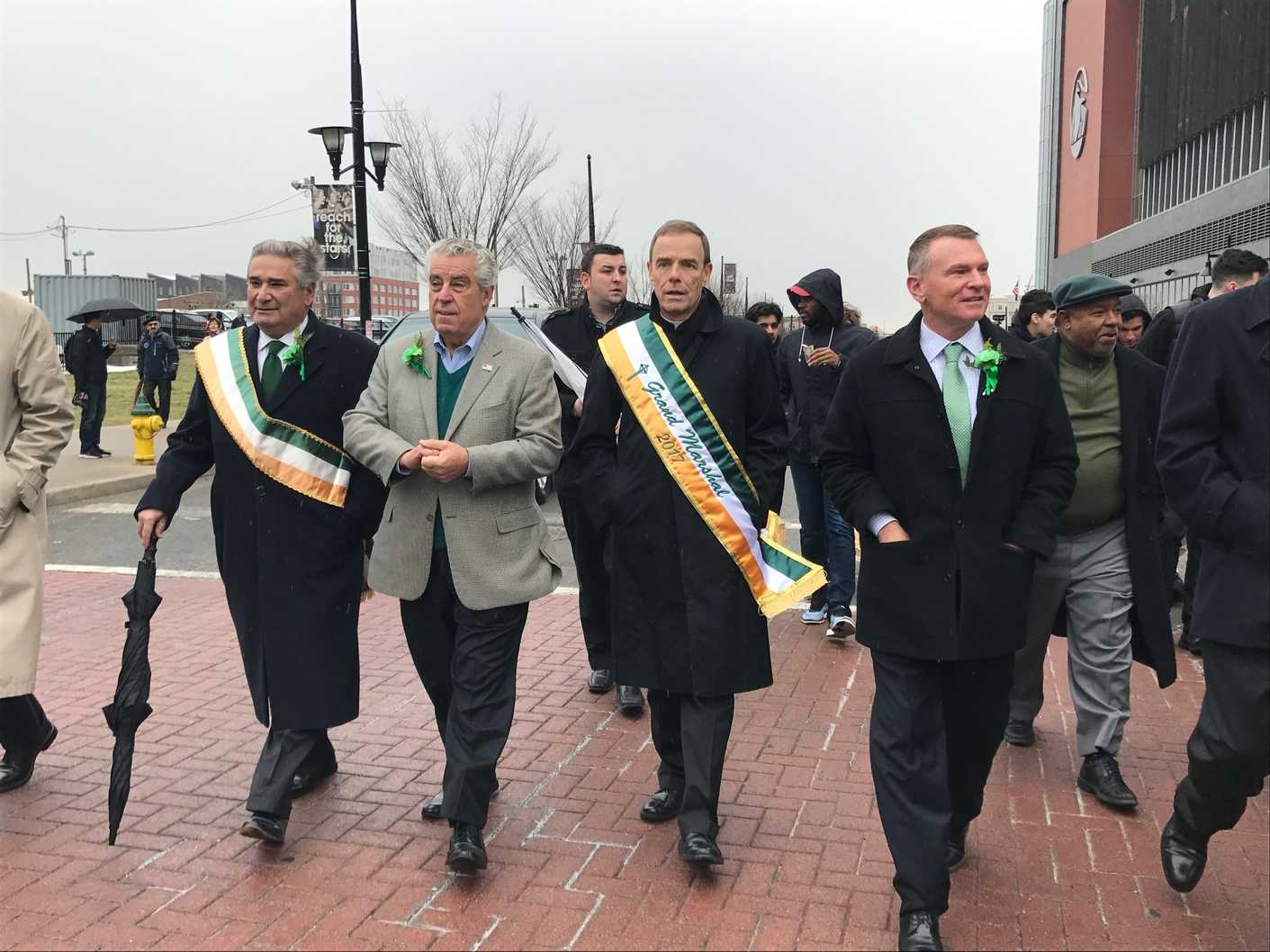 Fr. Edwin Leahy O.S.B. walks near the Prudential Center for the St. Patrick's Day parade.