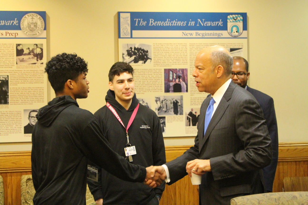 Former Secretary of Homeland Security Jeh Johnson greets Gray Section Leader Travis Wright.