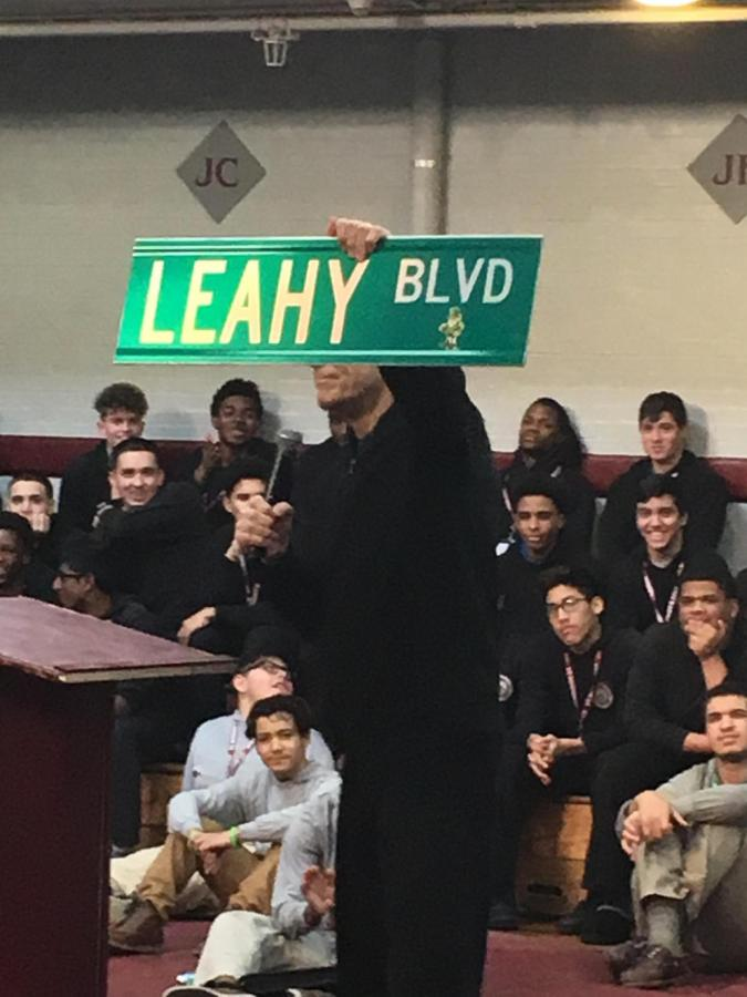 Fr.+Edwin+Leahy+brandishes+street+sign+at+convo+January+10%2C+2018.