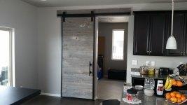 Custom Barn Door reclaimed from barn wood with steel frame