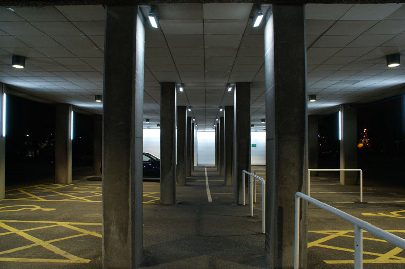 Iluminated columns in the car park. This image shows them set to white.