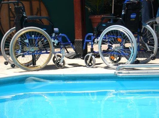 wheelchair hire bali motorcycle benidorm for disabled and less mobile visitors wheelchairs beside pool image