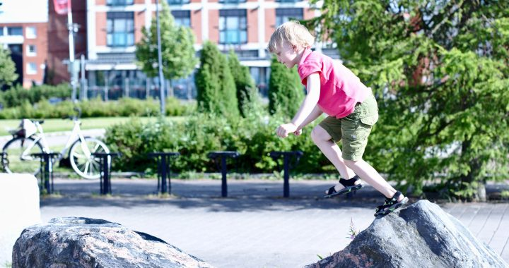 Child Jumping On Rocks