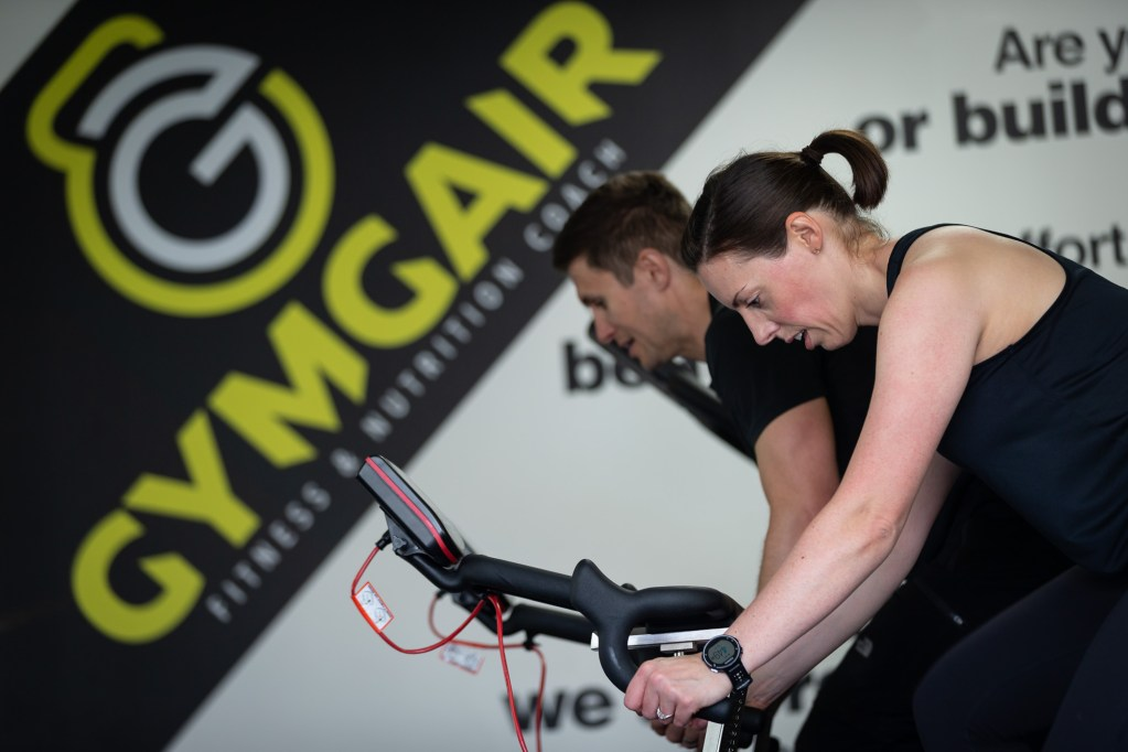 Russell & Linda of Gym Gair on exercise bikes - photo by Ben Mullay