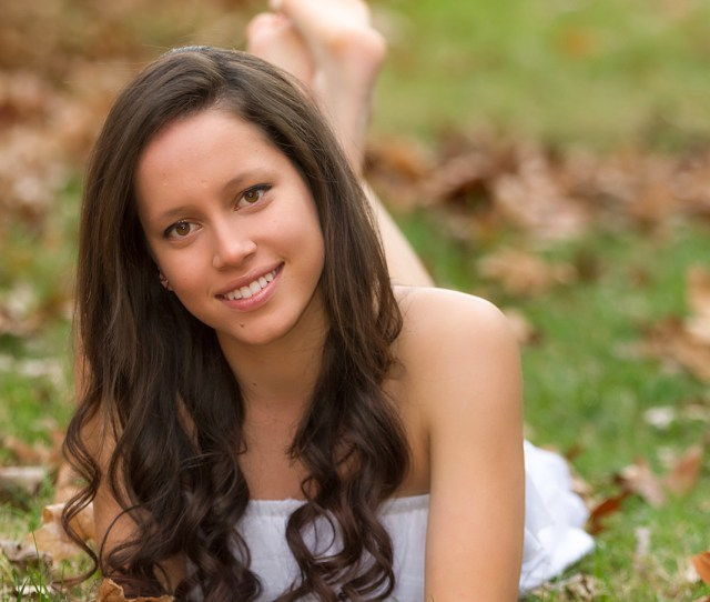 Cute Senior Photo Of Marylen With A Pretty White Dress That Was Long And Flowing And Wooden Fence In The Background