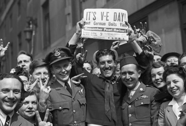Crowds in Times Square gather to celebrate the German surrender during World War II.