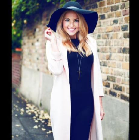 Blonde model in black dress and hat