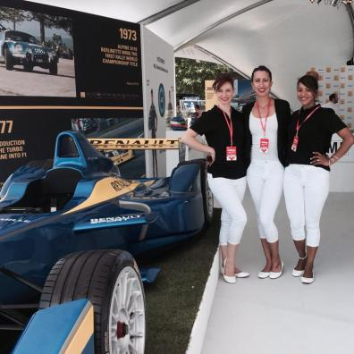 Motorsport promotional staff in white and black uniform