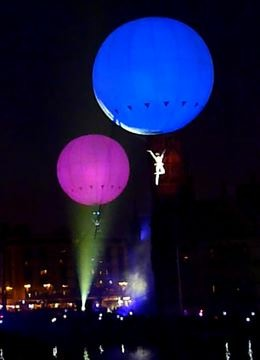 Circus acts with aerial skills performing air balloon act