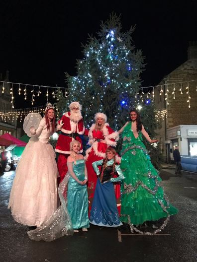 Christmas theme staff and stilt walkers