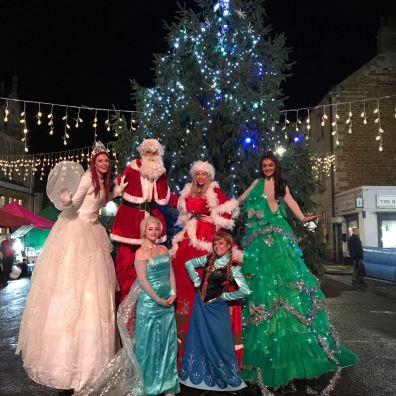 Christmas theme staff and stilt walkers