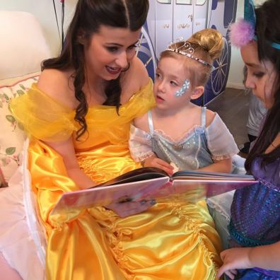 Belle reading stories at Princess Party