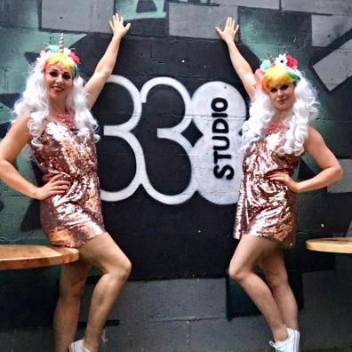 Event staff dressed as sparkly unicorns