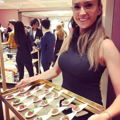 hospitality staff serving canapés to guests at store opening
