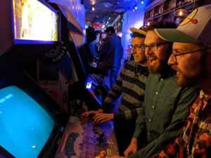 My bros and I looking in disbelief as the arcade cabinet blue screens on us. We're laughing about it though. The vibe is good, I miss bars even though I don't even drink.