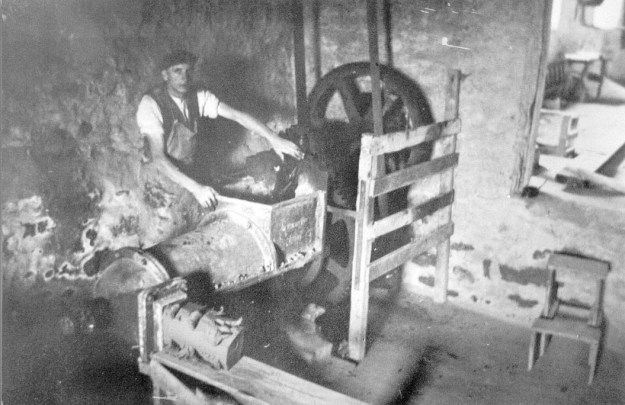 Charlie Armour pugging clay at Waterside pottery in 1940. Burton-in-Lonsdale Pottery walk
