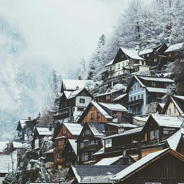 A building with a mountain in the snow