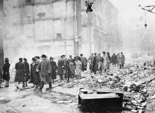 Photo of Londoners going to work after an air raid during the London Blitz