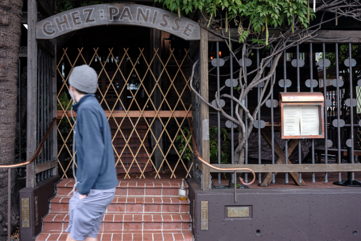A pedestrian walks past the entrance of Chez Panisse on an early Sunday morning. October 25, 2020.