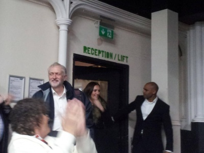 Labour leader Jeremy Corbyn (L) is applauded as he enters the Trinity Centre. Labour's mayoral candidate Marvin Rees (R) holds open the door. Photo: Iain Walker