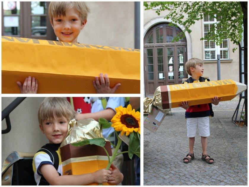 Kraftprobe für Kind 1.0: Stolzer ABC-Schütze mit seiner Bleistift-Schultüte