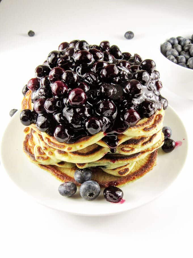 Go on blueberry overload with these blueberry pancakes with homemade blueberry compote. Enjoy plump, juicy blueberries and sweet, thick compote in every bite.