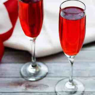Champagne grenadine spritzer is an elegant yet simple and refreshing beverage made with bubbly Pink Moscato champagne and cherry flavored grenadine.