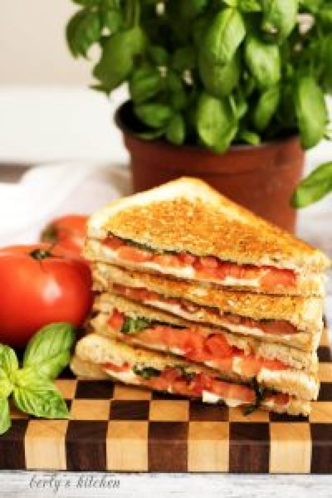 A grilled cheese margarita sandwich with perfectly toasted sourdough and all the flavors of the famous pizza including basil, mozzarella, and tomatoes.