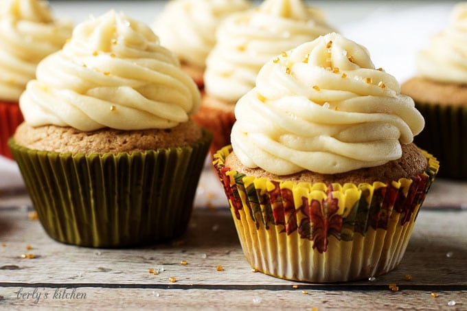 Spiced cupcakes with maple buttercream are a wonderfully sweet dessert filled with the warm flavors of Fall. Cinnamon, nutmeg, and ginger mix perfectly with the subtle flavor of maple.