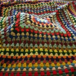 photo of colorful crocheted afghan
