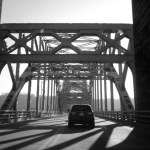 car crossing onto bridge