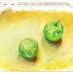 pastel sketch of apples on counter