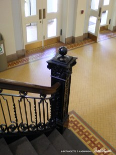 The restored railing, floor and doors in the Music Hall lobby.
