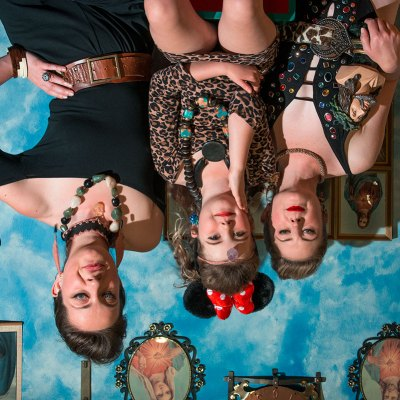 Upside down photo of two women and a child