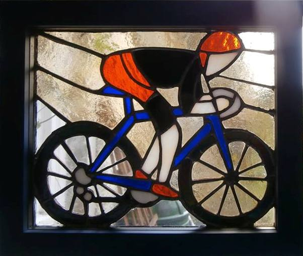 bespoke glass panel of a cyclist