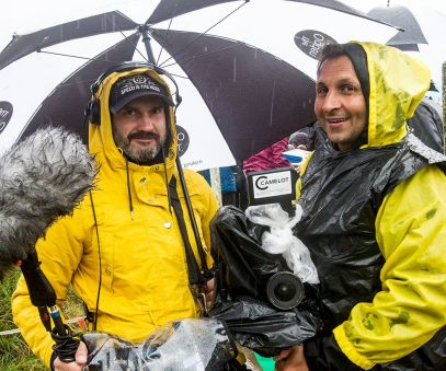 German film crew trying to keep their kit dry