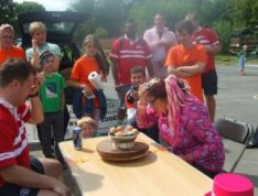 Lady Lily the Pink trying Russian Egg Roulette at World Alternative Games