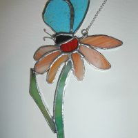 Blue butterfly on orange gerbera flower