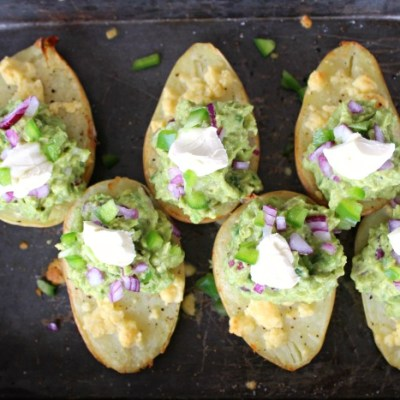 potato halves with melted cheese and guacamole