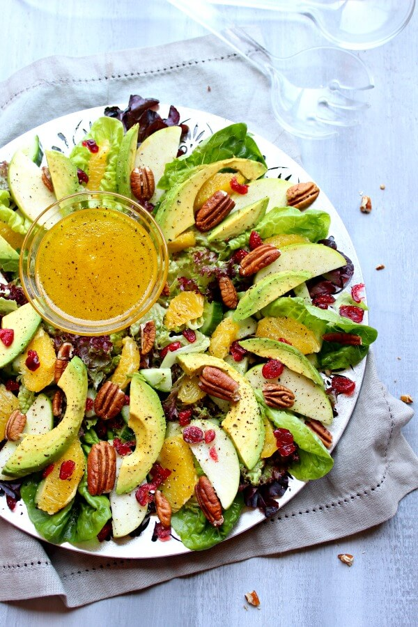 Pecan Cranberry & Avocado Salad with Orange Dressing. A colourful salad recipe perfect for Christmas or any special occasion. Healthy, quick & easy, the perfect side dish | berrysweetlife.com